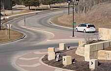 Illustration of car stopped at pedestrian crossing - Roundabouts Iowa Dot