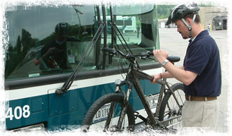 Loading bike onto bus rack