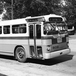 1950s bus pulling away from the curb